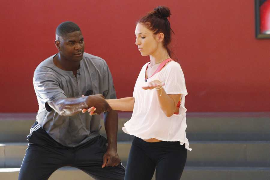 "SHARNA BURGESS & KEYSHAWN JOHNSON - This season's dynamic lineup of stars -- including a sitcom legend, a reality mega-star, a football champion and a pop music sensation - will perform for the first time on live national television with their professional partners during the two-hour season premiere of ""Dancing with the Stars. (Photo Credit: ABC/Rick Rowell)"