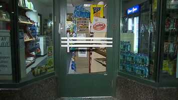 Somebody broke the glass front door of the convenience store.(Video: Watch our report)