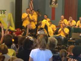 The Pirates honored Clemente by donating supplies and their time to the school on the city's North Side, joking with the children and even dancing with them.