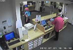 Security camera images show Sharon Flanagan with her 2-year-old child in the Best Western hotel lobby in Green Tree.