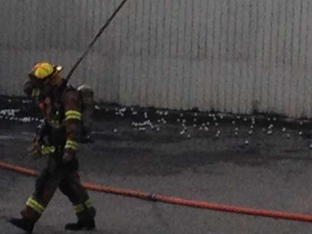 A firefighter walks past golf balls scattered across the parking lot after the Cool Springs fire.