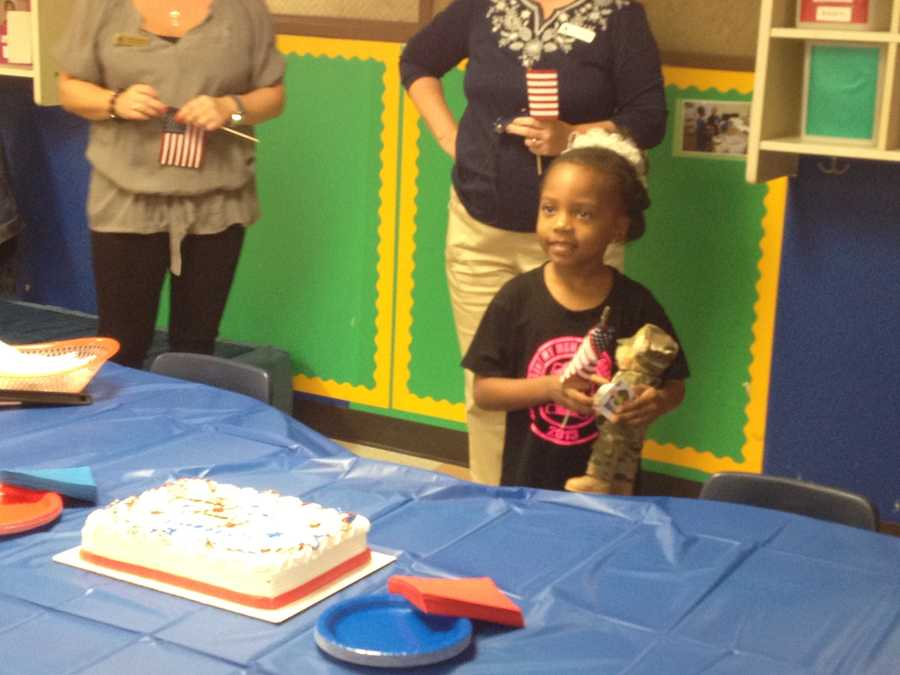 The students celebrated with a cake and miniature American flags.
