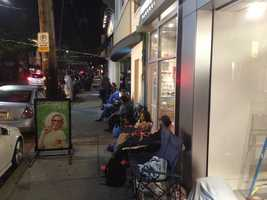 Customers spent the night outside on Walnut Street in Shadyside, waiting for the Apple store to open so they could buy a new iPhone.