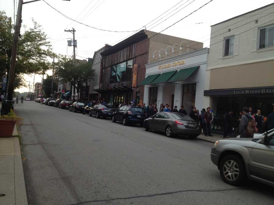 As daylight comes, Apple customers start to make their way into the Shadyside store to buy new iPhones.