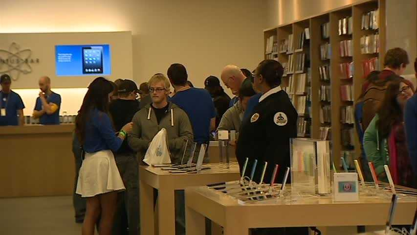 The line eventually shrank, but the store remained full of customers all morning.