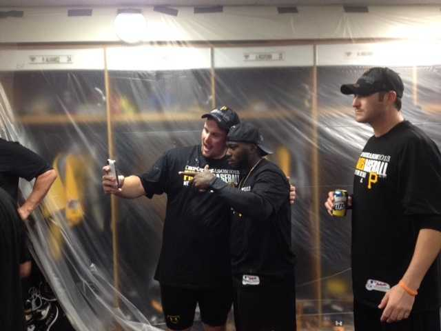Travis Snider and Josh Harrison celebrate with a picture.