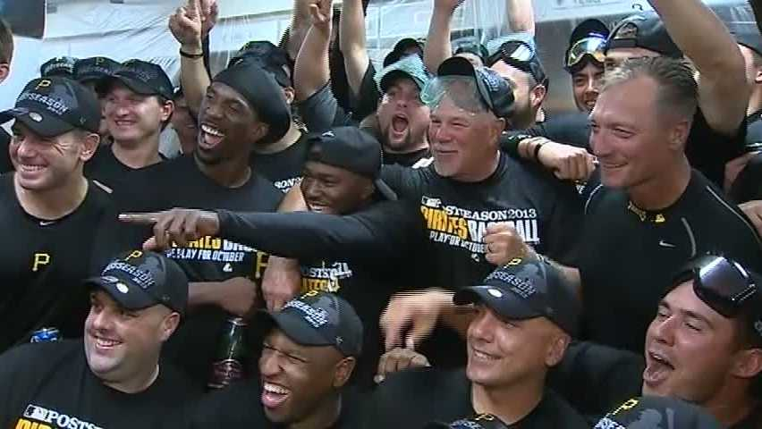 The Pittsburgh Pirates celebrate with beer and champagne after beating the Chicago Cubs at Wrigley Field and learning that they qualified for the playoffs.