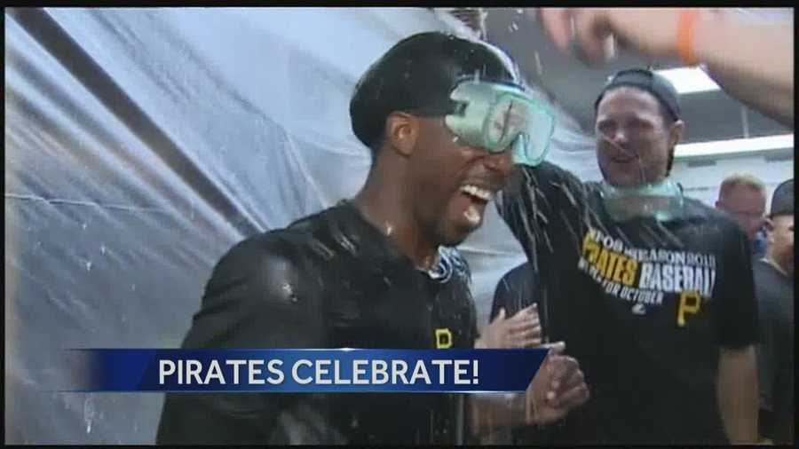 "The Pirates chanted ""MVP"" and drenched Andrew McCutchen with beer and champagne in Chicago after clinching a playoff berth Monday night."