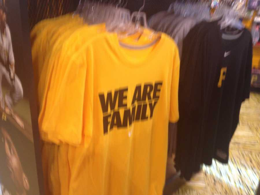 """Of course, it's always cool to go retro with a """"We Are Family"""" shirt."""