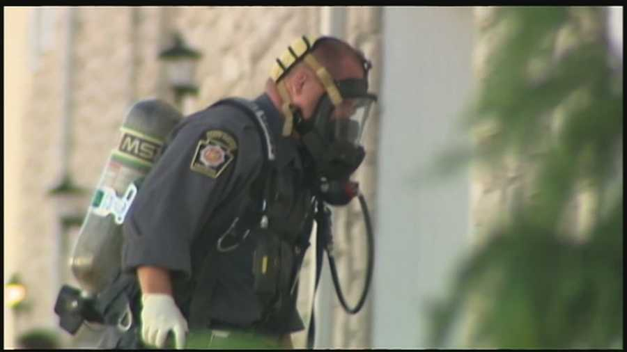 Police wore masks as they entered the home on Arrowhead Drive because it was full of tear gas.
