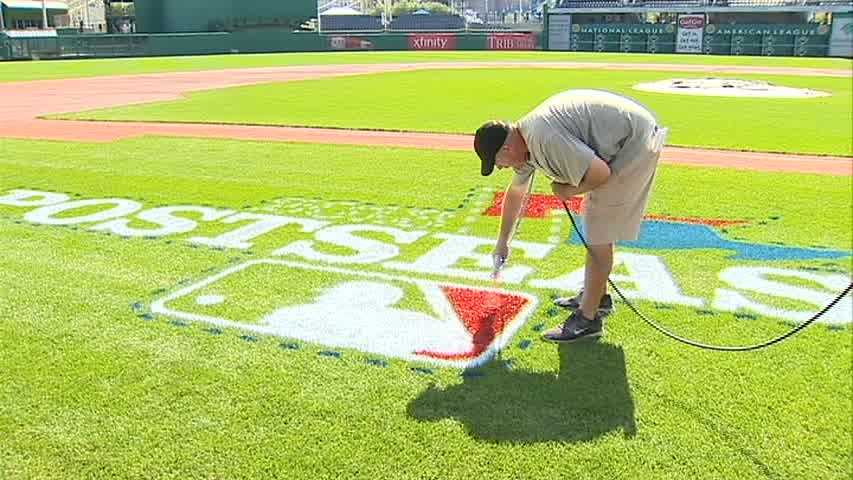 A Major League Baseball postseason logo is painted on the grass at PNC Park for the first time ever, as the ballpark prepares to host the NL Wild Card Game.