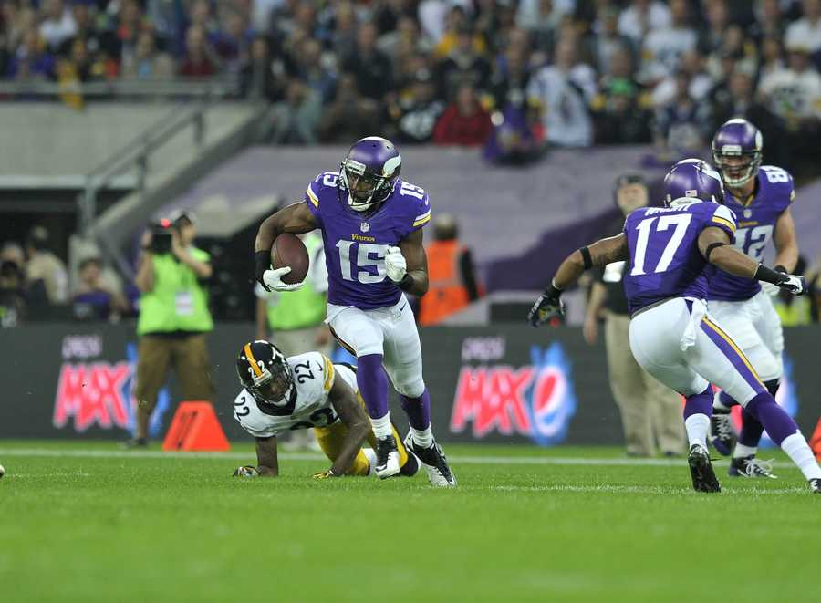 Vikings receiver Greg Jennings races toward the end zone.