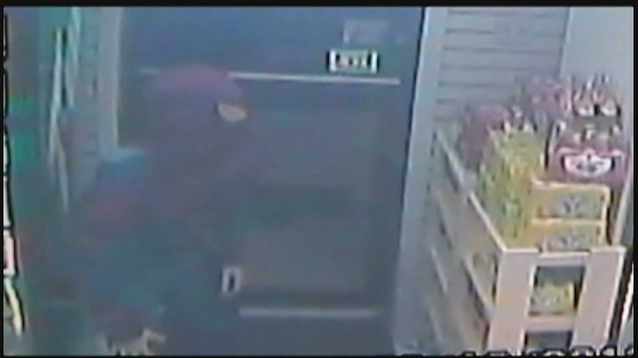 A surveillance image of Johnathan Hewson dressed as Spider-Man inside the Atwood Xpressconvenience store inOakland.
