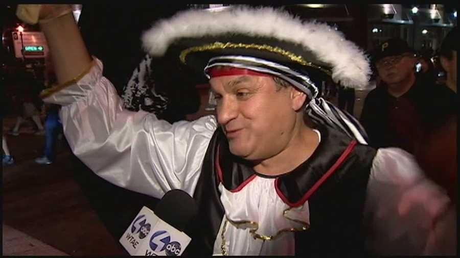 """I promised my son that after 21 years, if the Pirates make the playoffs, I'd dress as a Pirate -- and here we are,"" Charlie Petredis said."