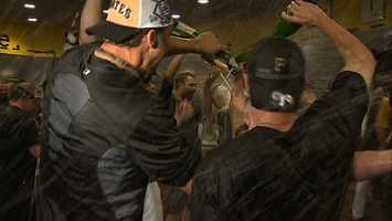 Inside the Pirates locker room, players doused each other with champagne and beer after beating the Cincinnati Reds in the NL Wild Card Game