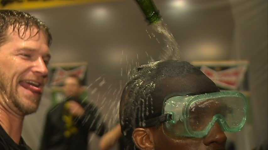 A.J. Burnett sneaked up behind Andrew McCutchen in the middle of an interview and doused him with bubbly.