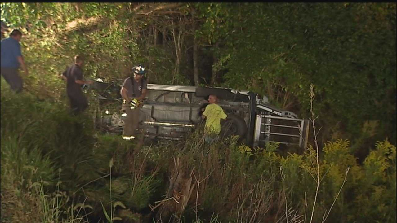 Driver, man in wheelchair freed from van crash