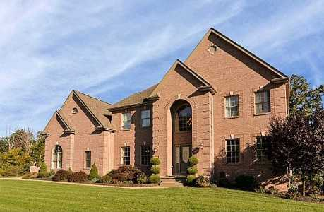 Take a tour of this custom built home that includes a gourmet kitchen, a sauna, finished basement with bar, and much more. The home is on the market for $719,000 and is featured on realtor.com.