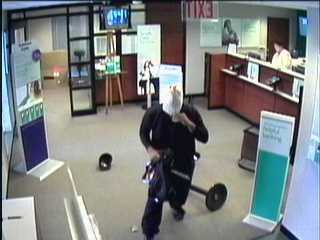 The robber tripped on his way out, dropping a baseball cap and some of the cash, police said.