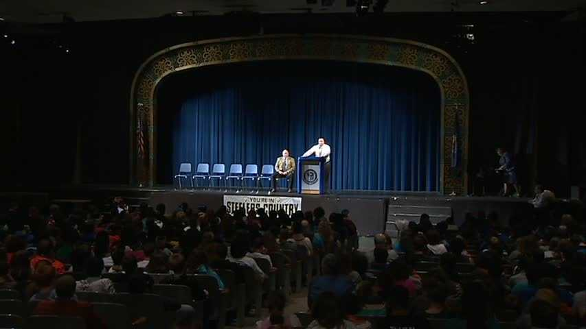 Former Steelers running back Jerome Bettis stopped by Woodland Hills High School on Friday to present a $5,000 check on behalf of S&T Bank.