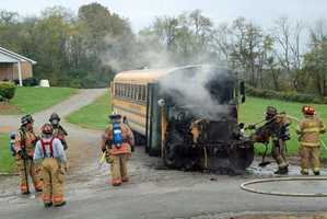 A school bus driver is being credited with getting nearly 20 students to safety after a bus caught fire Wednesday afternoon.