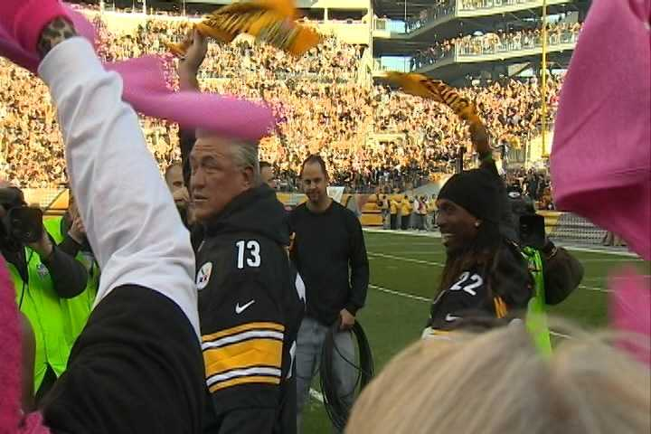 Pittsburgh Pirates manager Clint Hurdle and center fielder Andrew McCutchen lead the Terrible Towel wave before the Steelers-Ravens game at Heinz Field.