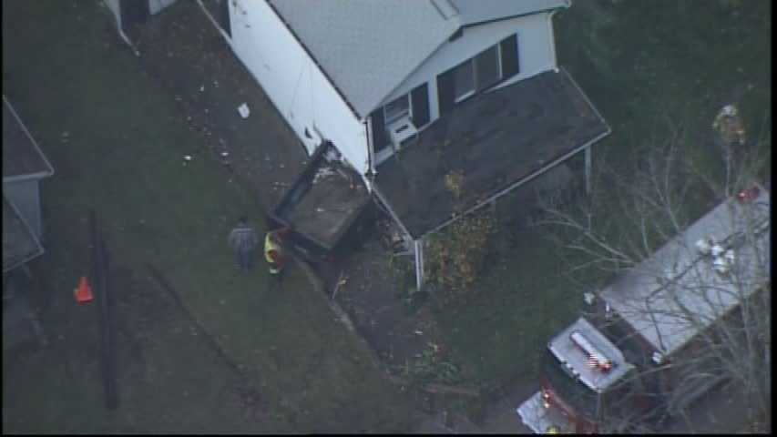 Sky 4 flew over the house in the 3600 block of Verona Road, where the truck plowed into the side of the home, near the front door.