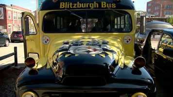 """Inside the black and gold """"Blitzburgh Bus,"""" it looks like any typical pregame tailgate before a Steelers game at Heinz Field, but upon closer review, it's being led by a group of diehard fans from 2,500 miles away."""