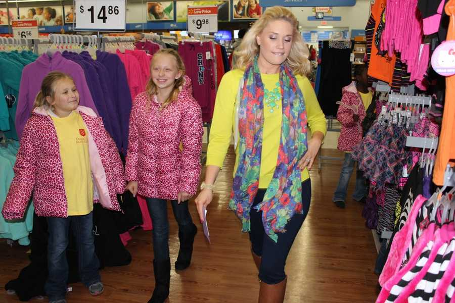 Jackie Schafer, Weekend Anchor, has fun with the girls by showing them how to walk the runway