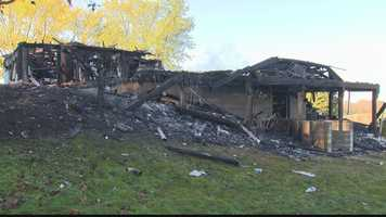 A husband and wife escaped injury as their home burned down Tuesday on Reese Road.
