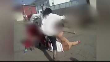 While the victim was on the ground, a woman (seen here) joined the fight and started kicking her several times in the back and head.