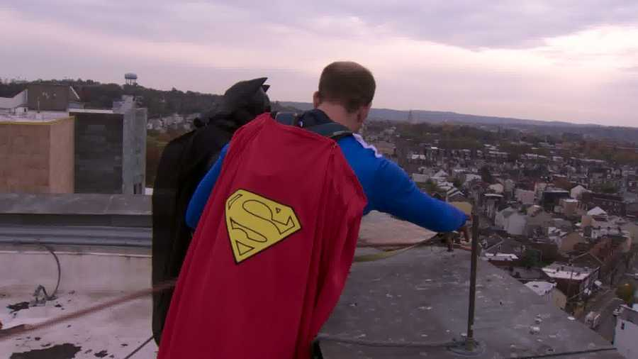 Here's Superman on the hospital rooftop with Batman, preparing to go over the ledge with his window-washing equipment.