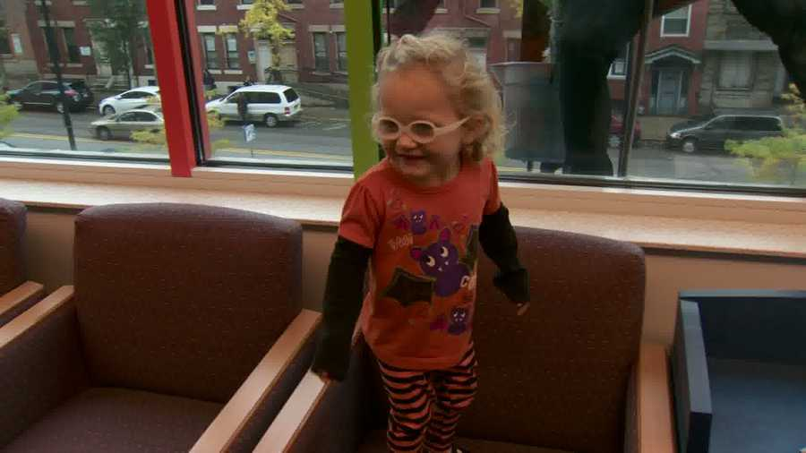 """On a cloudy day, the """"dark knight"""" was a ray of sunshine for this young girl."""