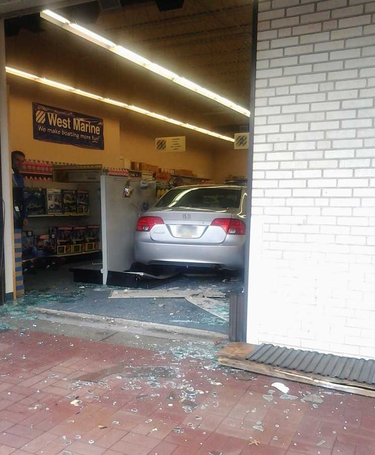 A car crashed into the showroom of a Ross Township boating supply store and went all the way inside the building.