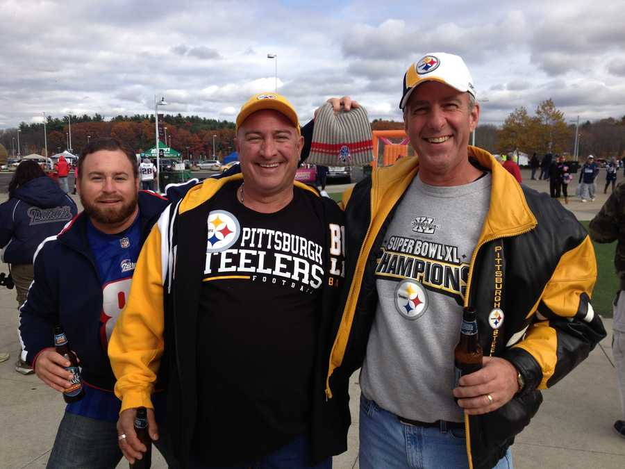Steelers fans get photobombed by a Patriots fan outside Gillette Stadium.