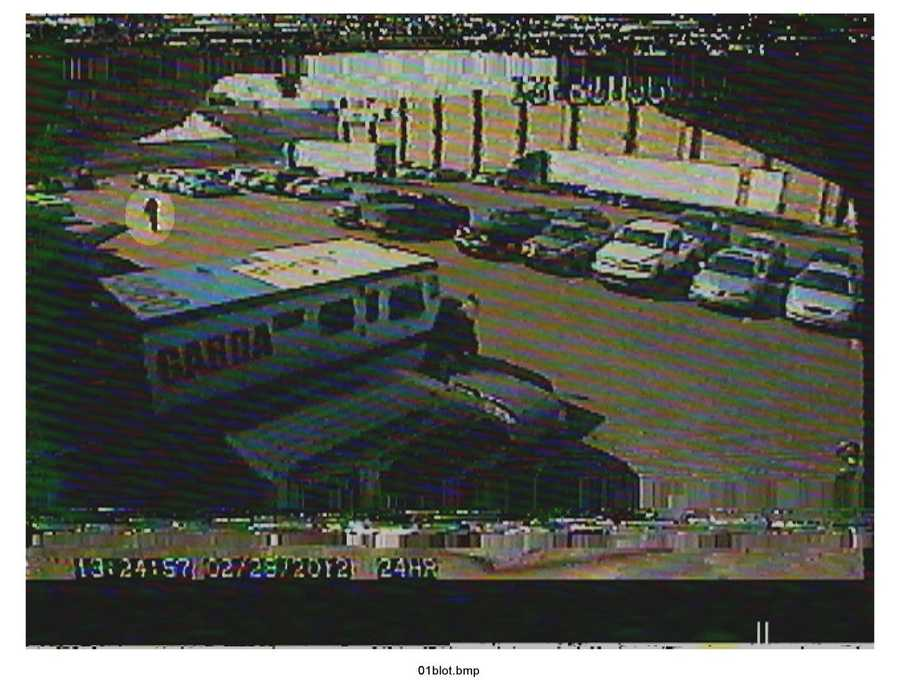 These freeze-frame images from a security video camera at the Garda Cash Logistics parking lot were presented as evidence at the trial. They show Konias running to his personal SUV.