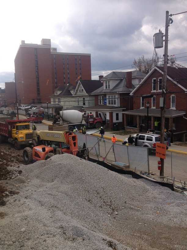An out-of-control cement truck rolled down a hill at a Morgantown, W.Va., construction site and crashed into the front of a residential building on Grant Avenue, forcing 10 West Virginia University students to move to emergency housing operated by the university.