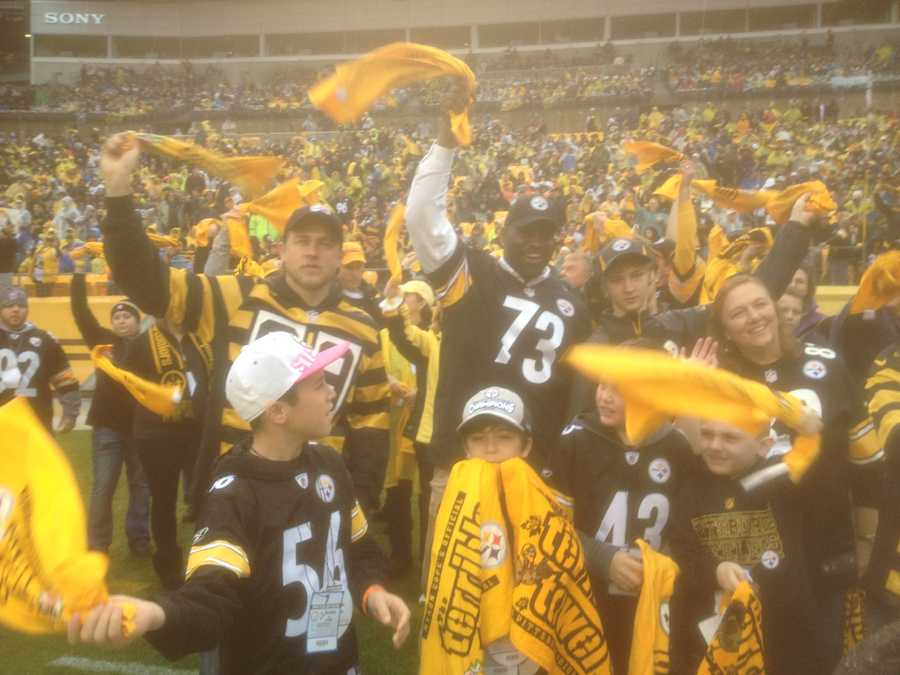 """Sons of Anarchy"" star Charlie Hunnam and former Steelers offensive lineman Kendall Simmons lead the Terrible Towel Twirl at Heinz Field."