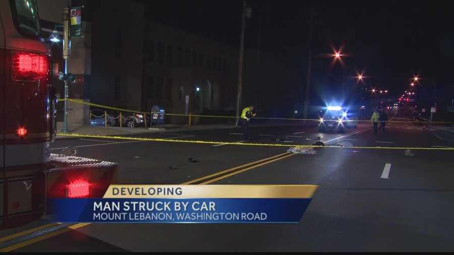 A car hit a pedestrian who was trying to cross Washington Road.