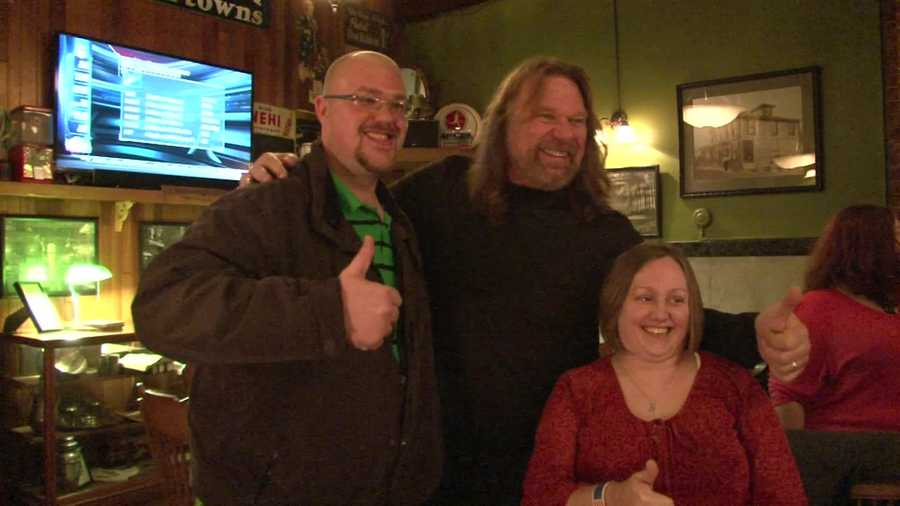 """Inside, """"Hacksaw"""" gives the movie a thumbs up while taking a picture with fans."""