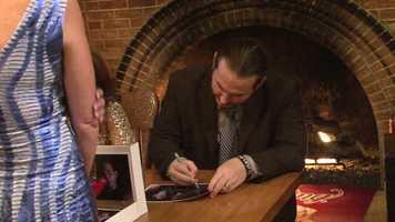 Matt Hardy signs an autograph