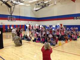 Air Force Sgt. Adam Schwiederwoski touched down in the U.S. on Friday and had been hiding at his parents' home until he could surprise his daughter, Autumn, at her school.