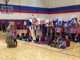 Sgt. Adam Schwiederwoski's daughter and her classmates gathered in the school gym to listen to a mystery guest read them a book. When Schwiederwoski revealed himself as the reader, Autumn ran up to him and the two embraced.
