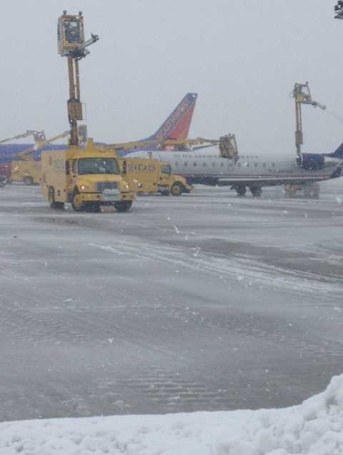 Deicing planes at Pittsburgh International Airport.