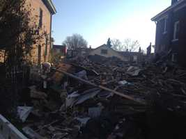 Massive holes were blown in both sides of the older two-story home on Dawson Street, near the Boulevard of the Allies.