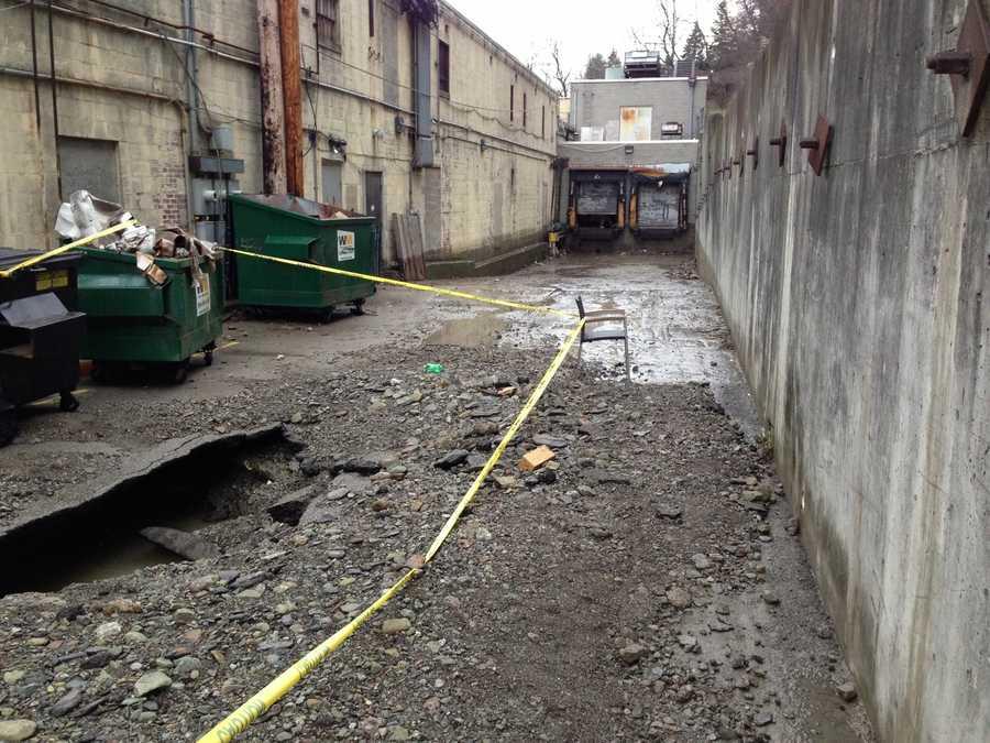 A water main broke near the loading dock behind Kuhn's Market in Banksville Plaza.