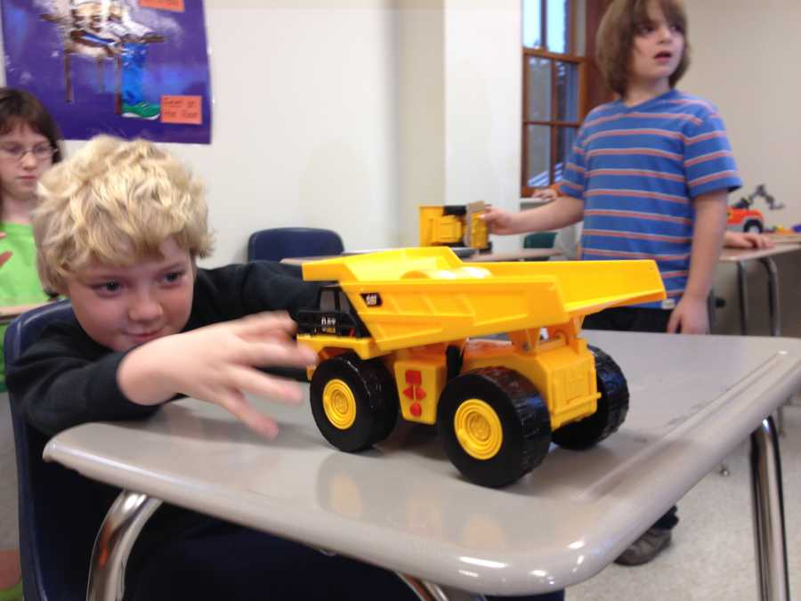 Maddox Derkosh's mother, Liz, helped deliver dozens of donated toy trucks to the students at The Watson Institute in Leet Township.