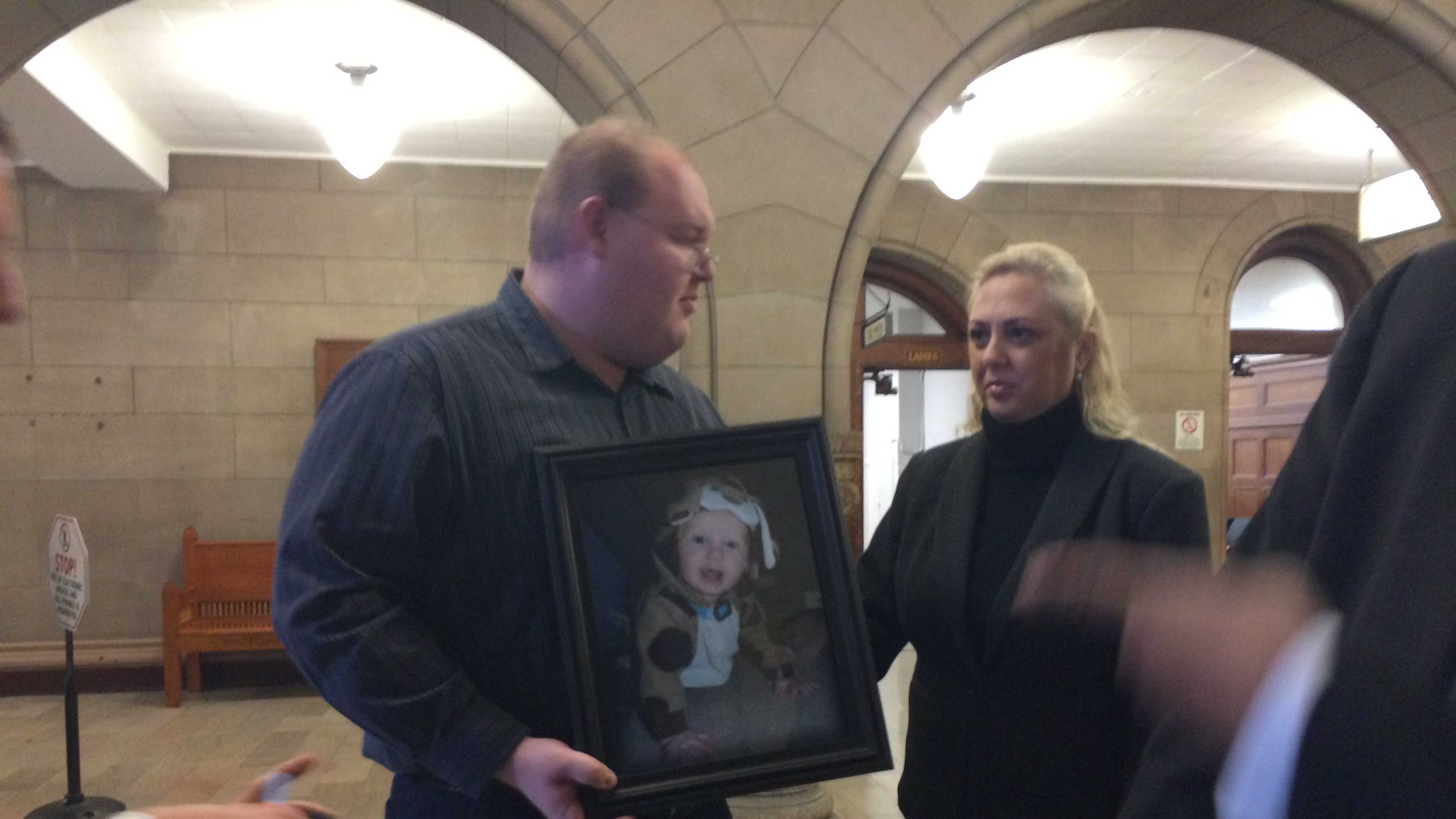 Steven Flanagan holds a photo of his late son, Steven.
