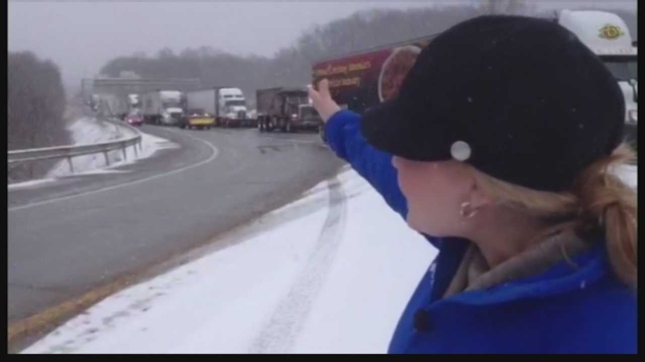 Ashlie Hardway points to the traffic backup caused by the closure of the westbound lanes of Interstate 70.