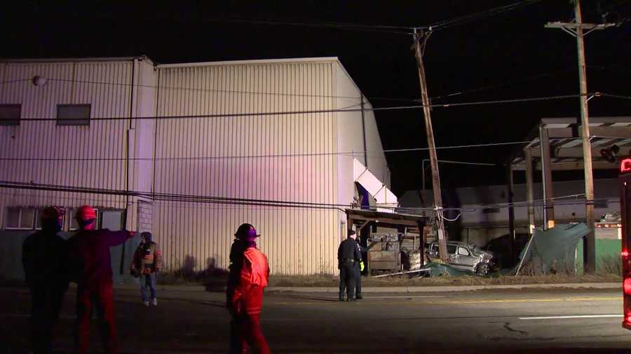 Police said the SUV drove through a fence, snapped a power pole and crashed into a wooden bin that holds discarded glass.